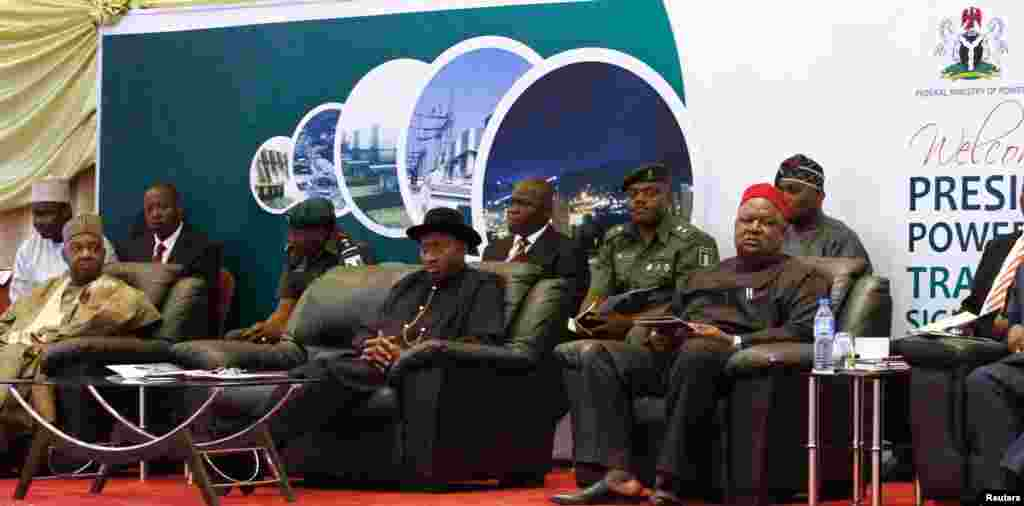 (Front seated, from L to R) Nigeria's Vice President Namadi Sambo, President Goodluck Jonathan and Secretary to the Government of the Federation (SGF) Anyim Pius Anyim attend the opening of the Presidential Power Reform Transaction signing summit.
