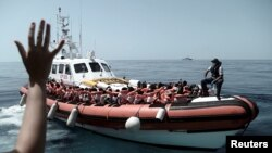 Migrants are seen after being rescued by Aquarius, a ship run in partnership between SOS Mediterranee and international aid group Doctors Without Borders, in the central Mediterranean Sea, June 12, 2018.