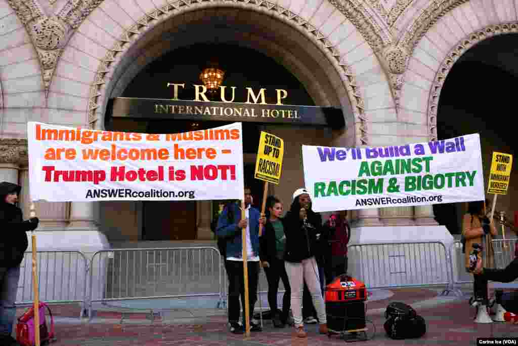 Hundreds protest Donald Trump at the opening of the International Trump Hotel at the Old U.S. Post Office Building in Washington, D.C. Trump was in town for the ribbon-cutting for the luxury hotel, less than two weeks before election day on November 8.