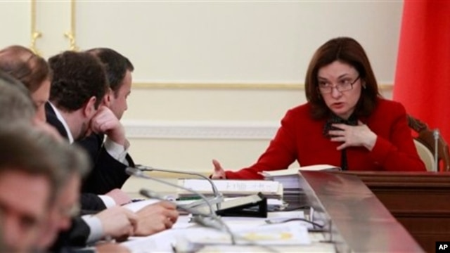 Russian presidential aide Elvira Nabiullina, right, at a meeting on fuel and energy, Novo-Ogaryovo residence, near Moscow, Feb. 13, 2013.