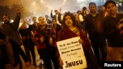 Demonstrators shout slogans during candlelight vigil marking first anniversary of deadly gang rape, New Delhi, Dec. 16, 2013.