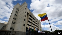 FILE - A Venezuelan flag flies outside the Supreme Court in Caracas, Venezuela, Jan. 22, 2021.