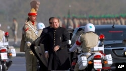 FILE - Pakistan's prime minister Nawaz Sharif, center, arrives to attend a military parade to mark Pakistan's Republic Day, in Islamabad, Pakistan, Thursday, March 23, 2017.