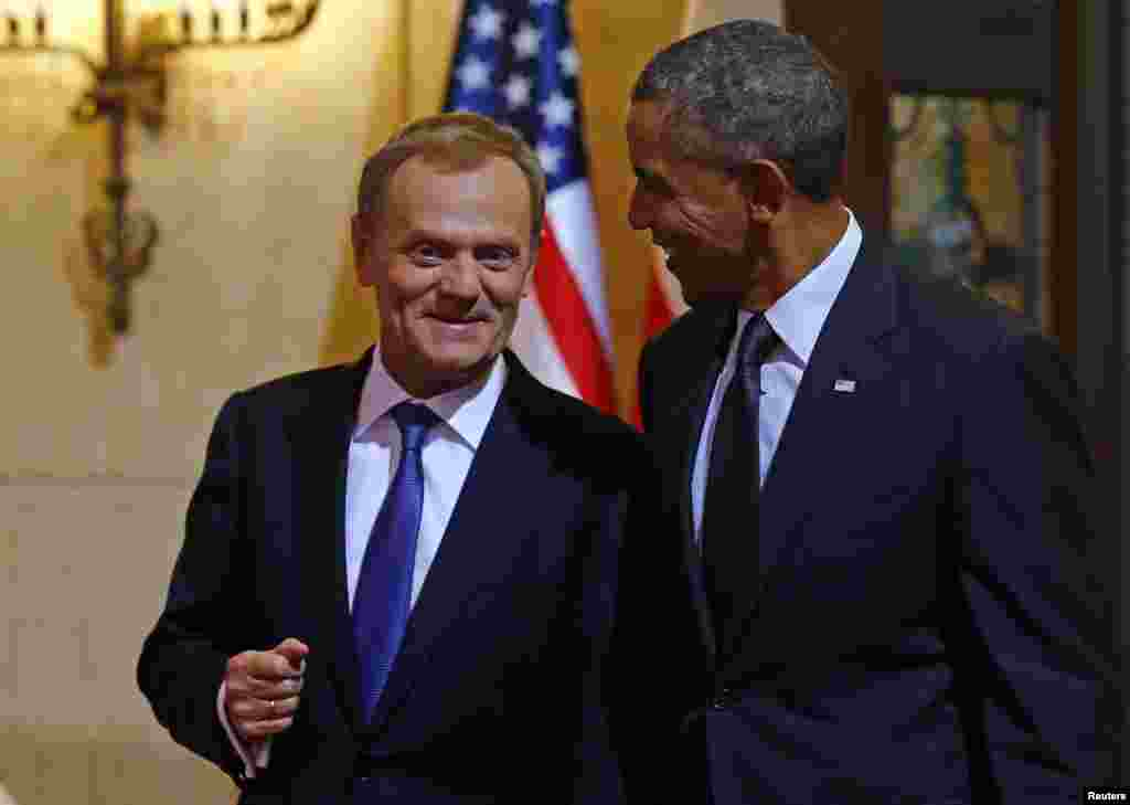 U.S. President Barack Obama is welcomed by Polish Prime Minister Donald Tusk in Warsaw, June 3, 2014.