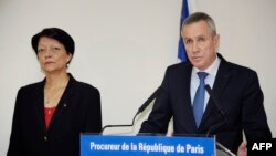 Paris chief prosecutor Francois Molins (R) speaks, next to the central director of French Judiciary Police Mireille Ballestrazzi, during a press conference on June 30, 2015 in Paris following a suspected jihadist attack on a gas factory in France.