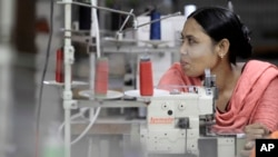 FILE - Bangladeshi garment worker Asma, who worked on the 4th floor of Rana Plaza garment factory, works at a factory meant to rehabilitate survivors of the accident.
