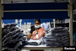 FILE - An employee sorts pieces of cloth at the Estee garment factory in Tirupur, in the southern Indian state of Tamil Nadu, June 19, 2013.