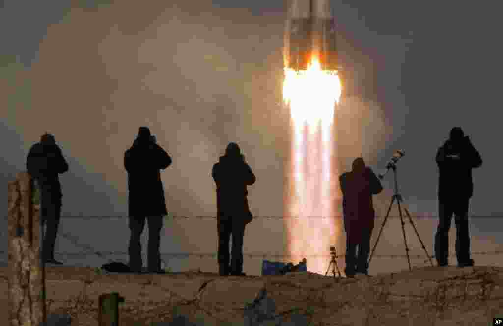 The Soyuz-FG rocket booster with Soyuz TMA-19M space ship carrying a new crew to the International Space Station, ISS, blasts off at the Russian-leased Baikonur cosmodrome, Kazakhstan.
