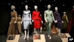 FILE - Oscar de la Renta outfits on display in Dallas.
