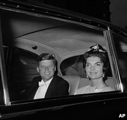 U.S. President John F. Kennedy and first lady Jacqueline Kennedy are shown in a car as they leave their residence at Quai D'Orsay, Paris, for a state dinner in the Hall of Mirrors in Versailles, France, June 1, 1961. (AP Photo)