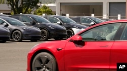 In this April 2, 2021 file photo new electric cars are parked at a Tesla delivery location and service center in Corte Madera, Calif. (AP Photo/Eric Risberg, file)