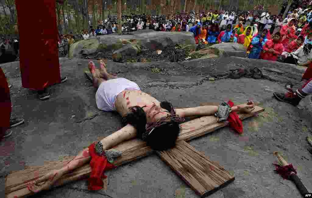A devotee enacts the crucifixion of Jesus Christ to mark Good Friday in Gauhati, India. (AP)