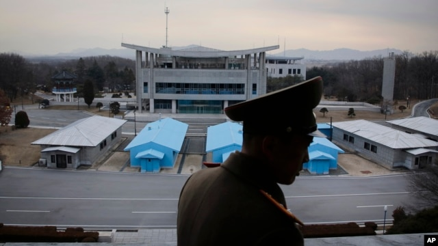 FILE - North Korean People's Army Lt. Col. Nam Dong Ho is silhouetted against the truce village of Panmunjom at the Demilitarized Zone (DMZ) which separates the two Koreas on Monday, Feb. 22, 2016. Critics say a confrontational approach to North Korean provocations has fueled regional tensions.