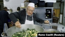 Dino Impagliazzo, Rome's 90-year-old 'chef of the poor', stirs a soup which he cooks for the homeless living in the city and outside the Vatican, in Rome, Italy, January 18, 2020