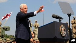 U.S. Vice President Mike Pence addresses servicemen participating in the Noble Partner 2017 joint multinational military exercises outside Tbilisi, Georgia, Tuesday, Aug. 1, 2017.