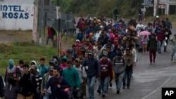 Honduran migrants walk along the roadside through Esquipulas, Guatemala, as they make their way toward the U.S. border, Jan. 16, 2019.