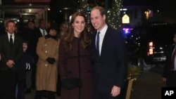 Kate (L), Duchess of Cambridge, and Britain's Prince William arrive at The Carlyle Hotel, Dec. 7, 2014, in New York.