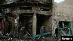 Hiện trường sau một vụ nổ bom tại khu vực Karrada ở trung tâm thủ đô Baghdad,