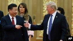 Archivo - El presidente de EE.UU., Donald Trump y su homólogo de China, Xi Jinping, se reunieron en el Gran Palacio del Pueblo en Beijing, China, el 9 de noviembre de 2017.
