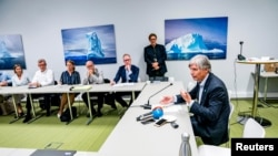 Norwegian Climate Minister Ola Elvestuen meets with representatives for business, climate organizations and research, as they discuss the situation in Amazon forest, in Oslo, Norway, Aug. 27, 2019.