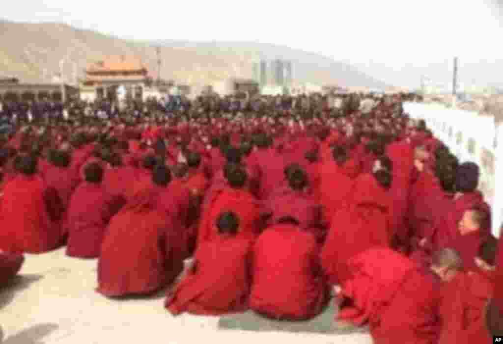 Monks gathered outside Rongpo monastery