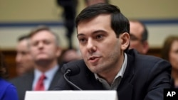 FILE- Pharmaceutical chief Martin Shkreli speaks on Capitol Hill in Washington, during the House Committee on Oversight and Reform Committee hearing on his former company's decision to raise the price of a lifesaving medicine, Feb. 4, 2016.