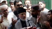 Muhammad Tahirul Qadri, Sufi cleric and leader of political party Pakistan Awami Tehreek (PAT) speaks to supporters before they begin their march to the capital from Lahore August 14, 2014. Thousands of anti-government protesters began to march on the Pak