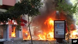 Flames are seen in a street after a blast in central Ankara. A bomb blast rocked the centre of the Turkish capital Ankara on Tuesday and some media reports said two people were killed, while a local mayor said nobody was dead but three people were serious