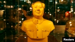 FILE - A golden bust of the late Chairman Mao Zedong, on display for sale at a Beijing department store.
