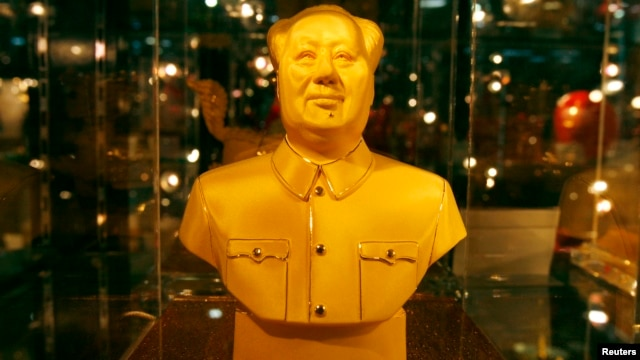 FILE - A golden bust of the late Chairman Mao Zedong.