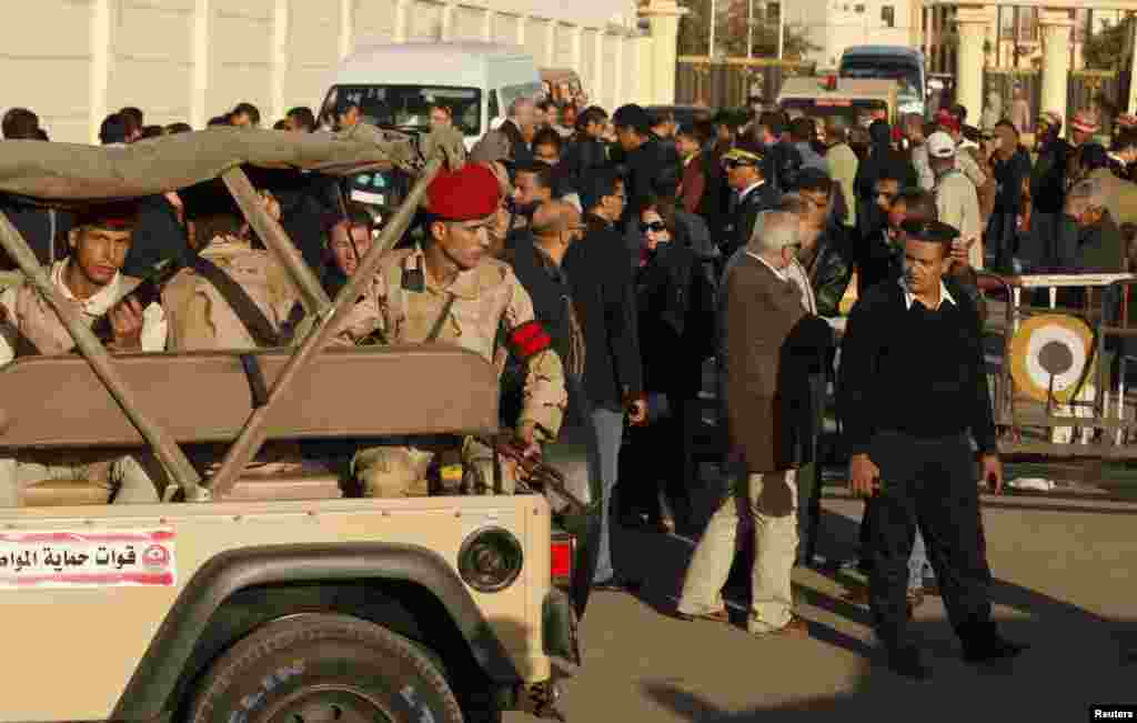 Soldiers provide security near the Almaza military airbase in Cairo during the funerals of army personnel killed in al-Arish.