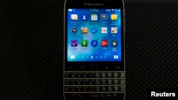 FILE - BlackBerry will continue to support the BlackBerry 10 operating system, but production of its Classic smartphone, shown at its launch in late 2014, will cease.