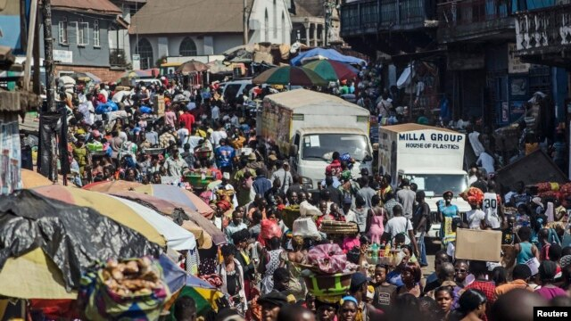 Shoppers and market vendors fill Sani Abacha Street in central Freetown, Sierra Leone, Jan. 4, 2013.
