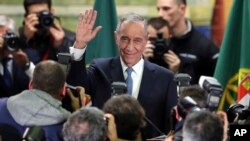 Marcelo Rebelo de Sousa waves to supporters after Portugal's presidential election, Jan. 24, 2016, in Lisbon.