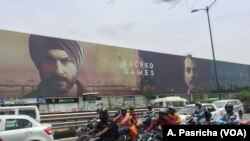 "Huge billboards at a New Delhi junction announced the arrival last month of the first original series produced by Netflix in India: ""Sacred Games,"" a thriller about the Mumbai underworld."
