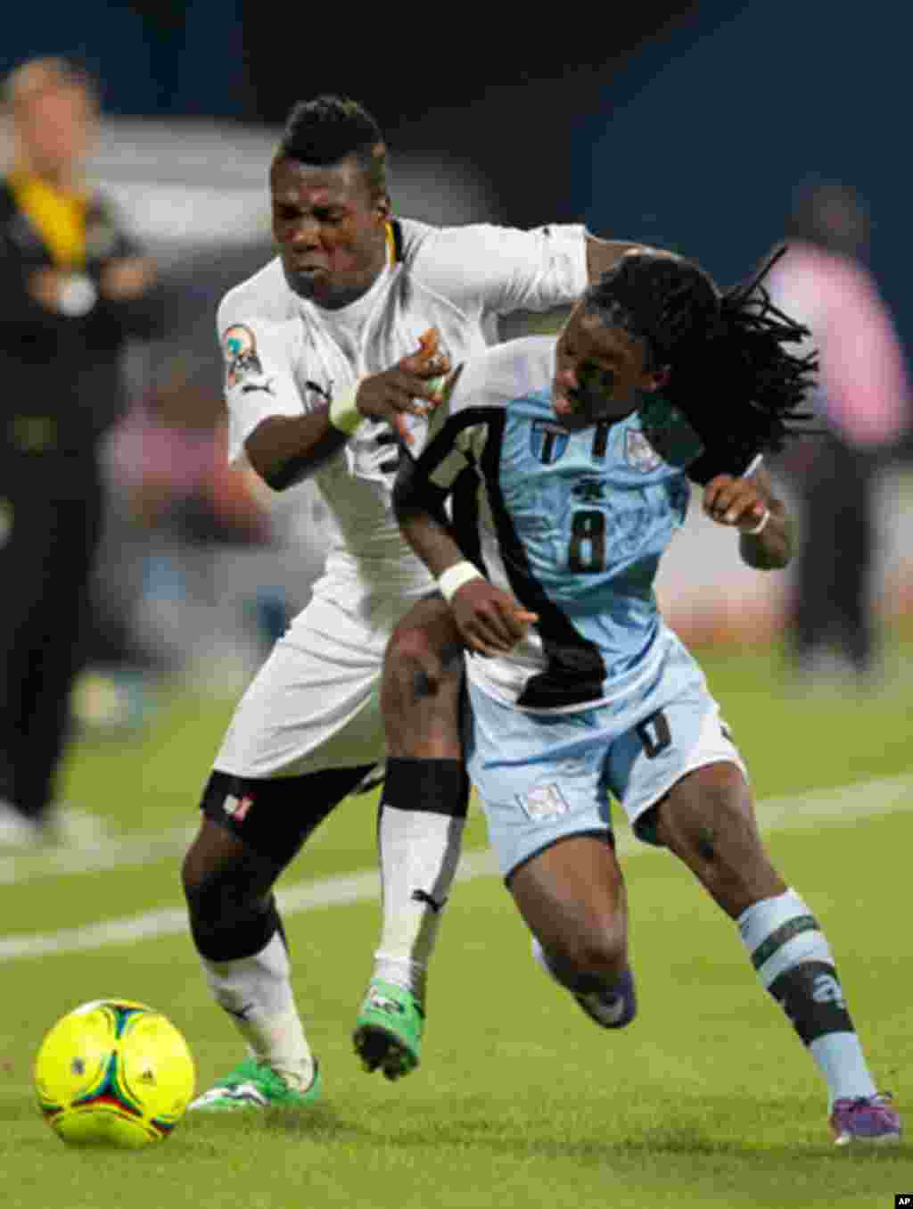 Ghana's Asamoah Gyan challenges Emmanuel Agyemang-Badu of Botswana during their African Cup of Nations Group D soccer match in FranceVille Stadium