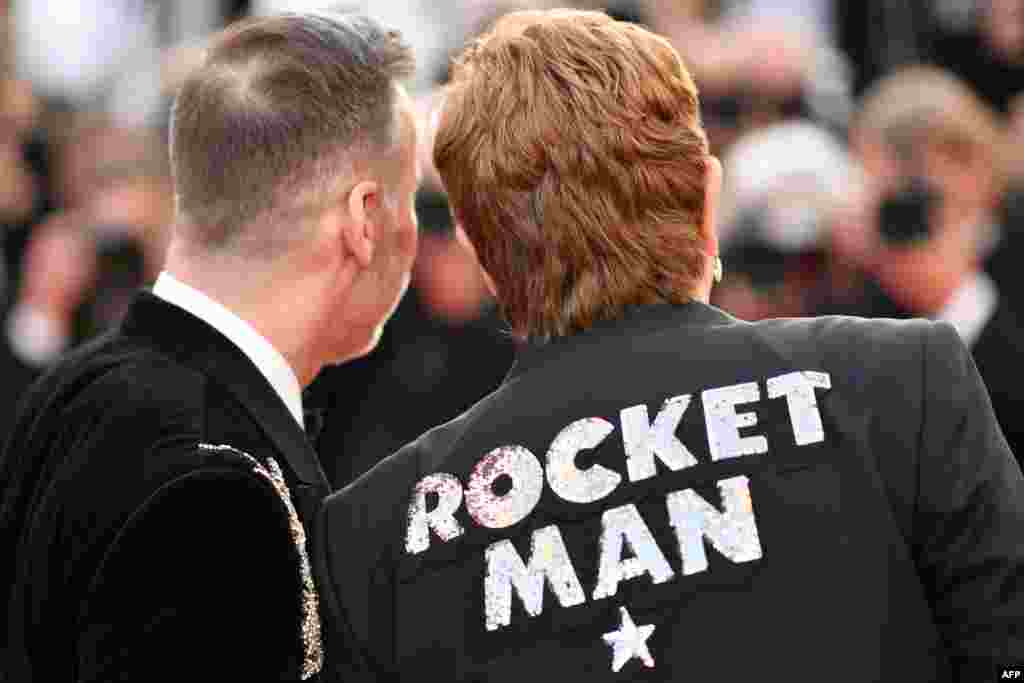 "British singer-songwriter Elton John (R) and his husband Canadian filmmaker David Furnish arrive for the screening of the film ""Rocketman"" at the 72nd edition of the Cannes Film Festival in Cannes, southern France, on May 16, 2019."