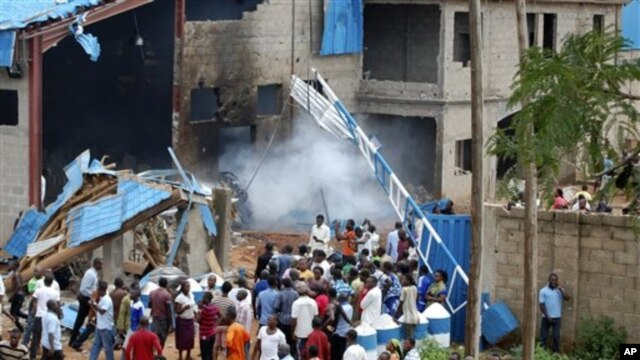 Scene outside outside a church following a blast in Kaduna, Nigeria, June 17, 2012.