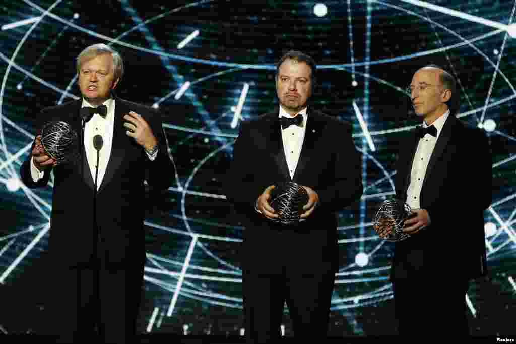 From left, Fundamental Physics co-laureates Brian P. Schmidt, Adam G. Riess, and Saul Perlmutter speak on stage during the second annual Breakthrough Prize Award in Mountain View, California, Nov. 9, 2014.