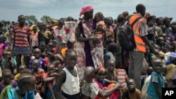 Men, women and children line up to be registered with the World Food Program for food distribution in Old Fangak in South Sudan.