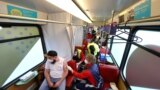 """A man receives a dose of the coronavirus disease (COVID-19) vaccine at the """"Vaccination-Express"""" (Impfexpress) train touring through the city in Frankfurt, Germany, Oct. 25, 2021."""