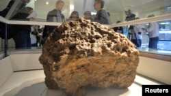 This is a piece of a meteorite that hit Russia in 2013. It was on display in Chelyabinsk, Russia in October 2013. According to local authorities and scientists, it was lifted from the bottom of the Chebarkul Lake. (AP PHOTO)
