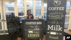 This Feb. 22, 2018 photo shows a coffee stand at Cypress Creek High School in Orlando, Fla. The school did not receive grants for the coffee bars, but the local dairy council provided signs and menu. (Orange County Public Schools via AP)