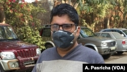 Amit Khanna, a resident of Gurgaon on the outskirts of the Indian capital, uses a face mask to protect himself from air pollution when he is outside.
