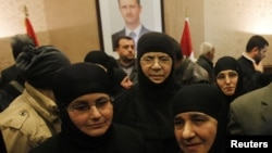 Nuns, who were freed after being held by rebels for over three months, arrive at the Syrian border with Lebanon at the Jdaydeh Yaboos crossing. Witnesses at the Syrian border with Lebanon said the nuns arrived at the crossing late on Sunday night and head