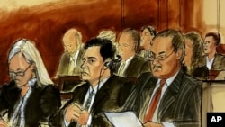 In this courtroom sketch Mehmet Hakan Atilla, second from left, listens to the judge during his sentencing, flanked by his attorneys Cathy Fleming, left, and Victor Rocco, May 16, 2018, in New York.