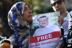 Tawakkol Karman, the Nobel Peace Prize laureate for 2011 holds a picture of missing Saudi writer Jamal Khashoggi as she speaks to journalists near the Saudi Arabia consulate, in Istanbul, Turkey.