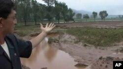 폭우로 씻겨 내려간 농경지