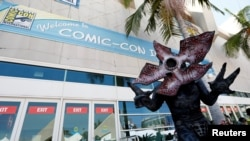"David Schoelen poses dressed like the character of Demogorgon from ""Stranger Things"" during the 2017 Comic-Con International Convention in San Diego, California, July 20, 2017."