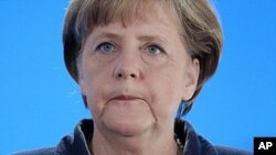 German Chancellor Angela Merkel speaks in Kiel, northern Germany, January 14, 2012.